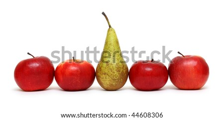 different concepts - pear between green apples - stock photo