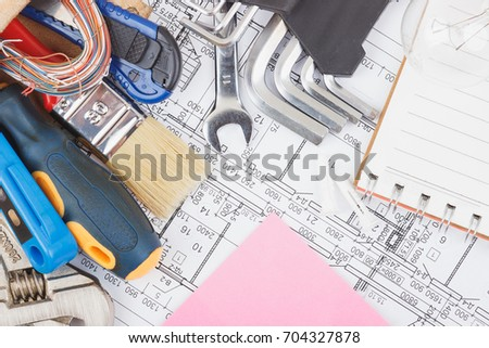Different construction tools and drawings, top view #704327878