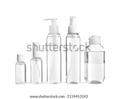 Different cosmetic bottles on white background #1159453243