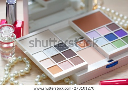 Different cosmetic products for beautiful woman