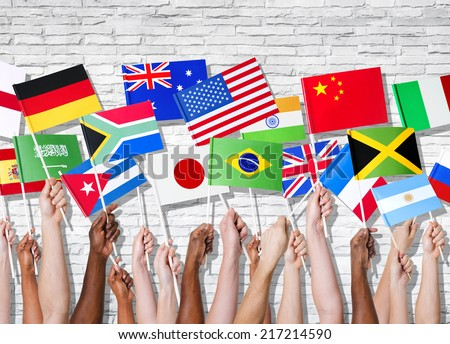Different countries united with their flags raised.