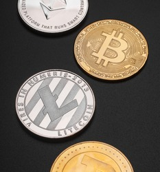 different cryptocurrencies coins btc, ltc, dogecoin and eth isolated on black background