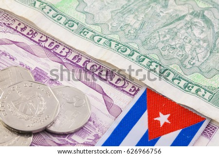 Different cuban banknotes and coins on the table.