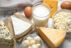 Different delicious dairy products on table, closeup