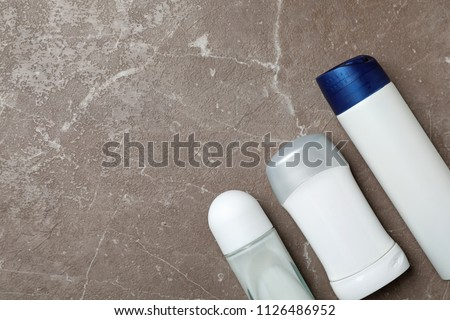 Different deodorants on color background, top view. Skin care