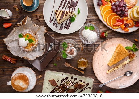Different desserts with fruits and coffee, top view #475360618