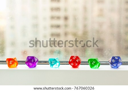 Different Dices for board games, near the window #767060326