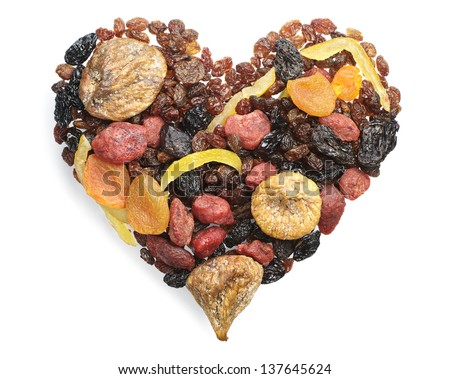 Different dried fruits in the shape of hearts on white