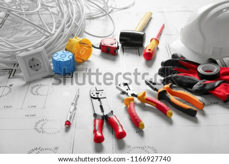 Different electrician's supplies on electrical scheme