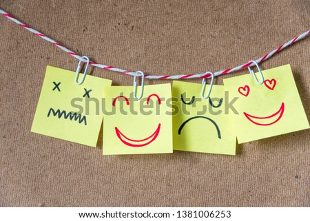 Different emotion faces drawing on sticky notes on blank board, positive attitude and happy concept. #1381006253