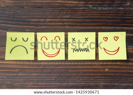 Different emotion faces drawing on sticky notes on blank board, positive attitude and happy concept. #1425930671