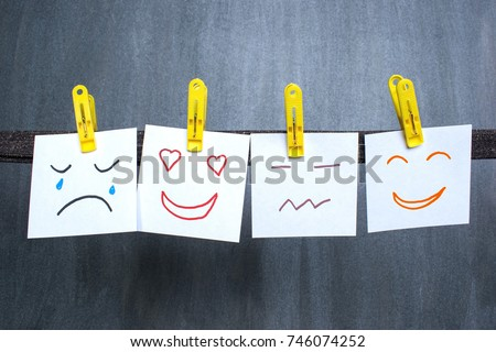 Different emotions drawn on notes, dark background.