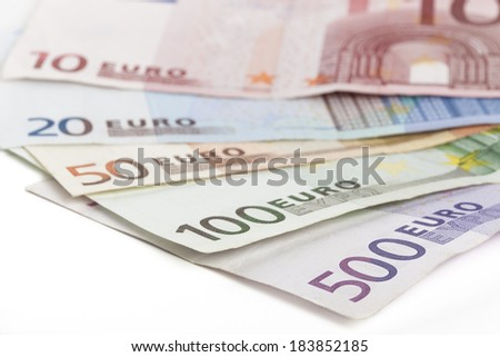 Different euro banknotes closeup on white background