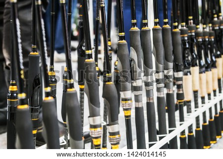 different fishing rods and spinning rods are the showcase of the fishing shop #1424014145