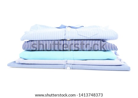Different folded baby clothes isolated on white background #1413748373