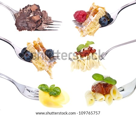 Different food on Forks isolated on white background