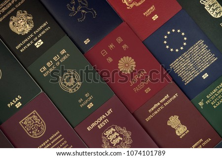 Different foreign passports from many countries by the world as colorful background
