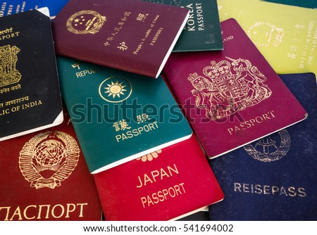 Different foreign passports from many countries & regions from the world as colorful background Foto d'archivio ©