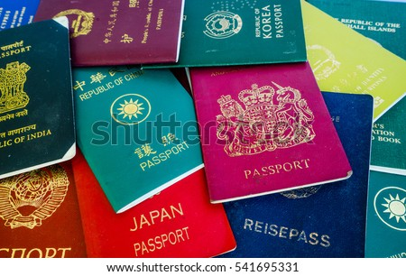Different foreign passports from many countries & regions from the world as colorful background