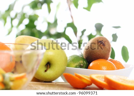 Different fresh fruits on the kitchen table