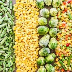 Different frozen vegetables as background, top view. Stocking up vegetables for winter storage. Assortment of frozen vegetables. Healthy food, Cooking ingredients