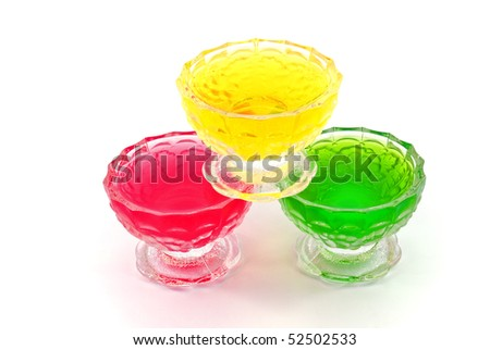 different fruit jelly in ice-cream bowls on white background