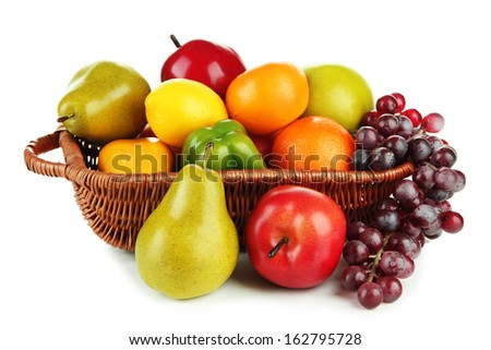 Different fruits and vegetables in basket isolated on white