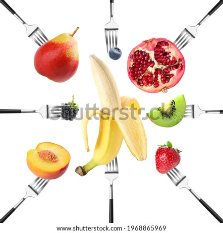Different fruits impaled on forks against white background Сток-фото ©
