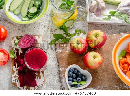 Different fruits, juice and vegetables. Healthy diet eating. Top view - Shutterstock ID 475737460
