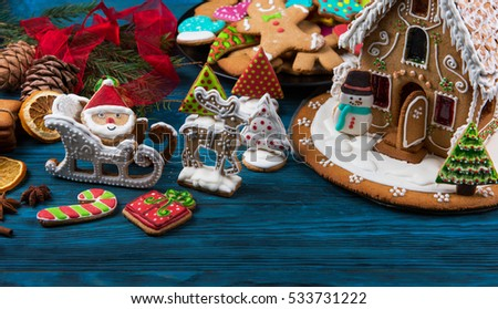 Different ginger cookies for new years and christmas on wooden background #533731222