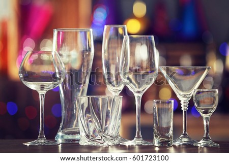 Different glassware on blurred background
