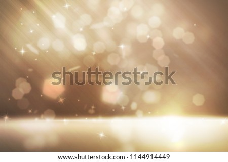 Different gold sparkles effect floating and have soft light floor at below scene with glitters falling on gold back ground #1144914449