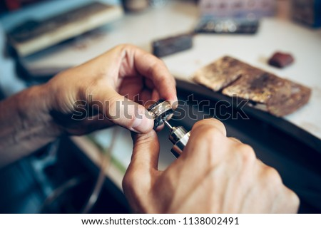 Different goldsmiths tools on the jewelry workplace. Jeweler at work in jewelry. Desktop for craft jewelry making with professional tools. Close up view of tools.