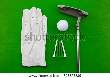 Different golf equipments on the green  desk - flat lay photography
