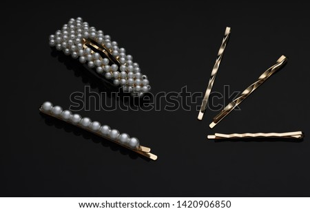 Different hairpin shapes on black background   Stockfoto ©