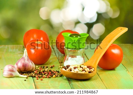 different ingredients for cooking on a green background closeup
