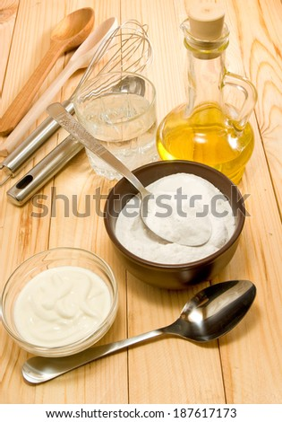 different ingredients for cooking on a wooden table closeup