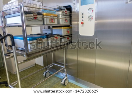 different instrument containers are pushed into a sterilization unit #1472328629
