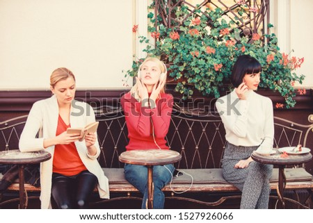 Different interests. Group pretty women cafe terrace entertain themselves with reading speaking and listening. Information source. Female leisure. Weekend relax and leisure. Hobby and leisure. #1527926066