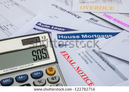 different invoices and bills and a calculator shows SOS, finacial concept