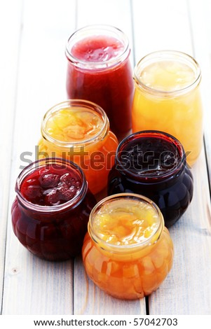 different jars full of fruity jam - food and drink