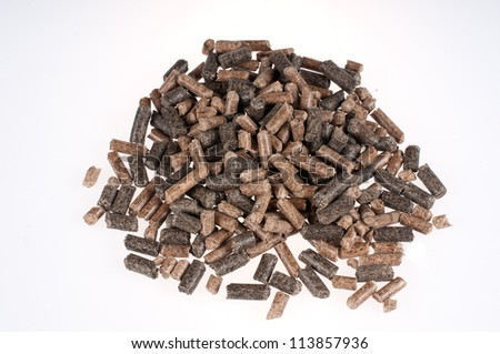 Different kind of pellets on a white background