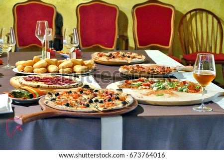 Different kind of pizzas served on table #673764016