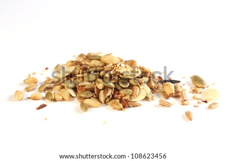 Different kind of roasted nuts on white background