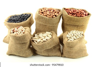 Stock Photo of Different kinds  Bean Seeds (legume, pulse) in burlap bags (sacks) front view  over white background.