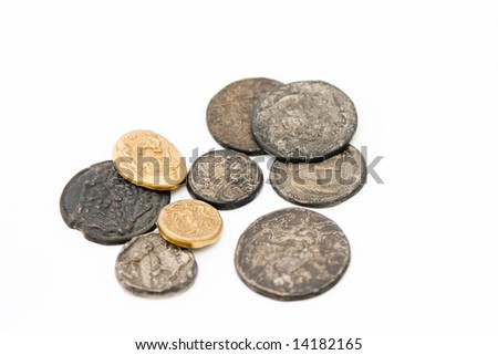 Different kinds of antique roman coins on white background