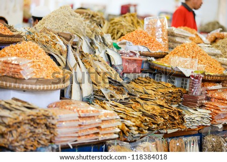Different kinds of dried fish and shrimps at market in Malaysia