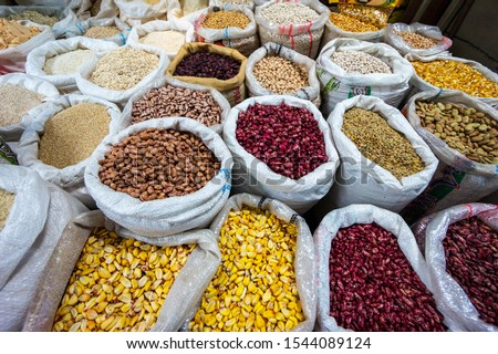 Different kinds of healty grains, legumes and beans in bulk bags at the market in Ibarra, Ecuador, South America. Organic healthy fresh vegan food.