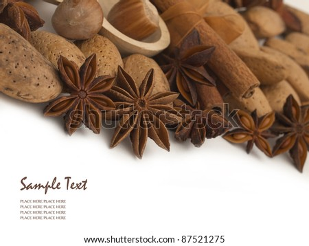 different kinds of nuts spices and decoration with place for your text