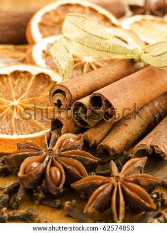 Different kinds of nuts, spices and dried oranges. Shallow dof.